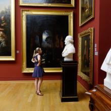 A female student views a statue inside a museum in Paris.