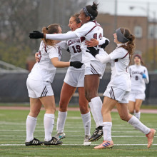 Members of UChicago's women's soccer team celebrate during a game.