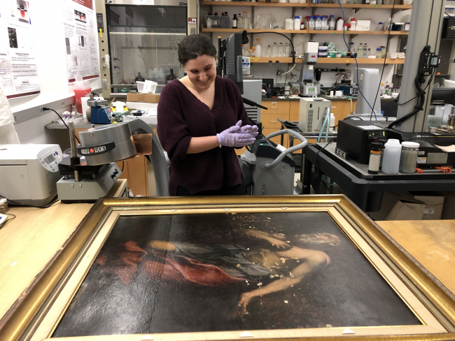 "Caroline Longo, student in Suzanne Deal Booth Seminar ""The Material Science of Art,"" prepares to use x-radiography to examine The Penitent St. Jerome at the Smart Museum of Art."
