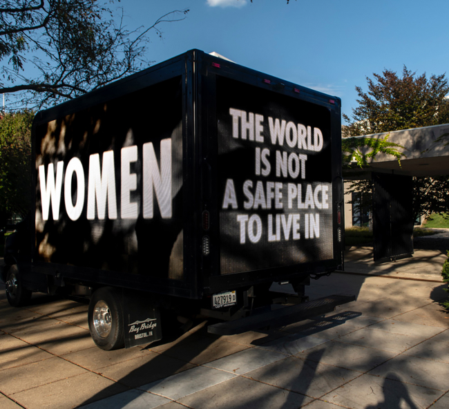 """Truck with text """"Women - This world is not a safe place to live in."""""""