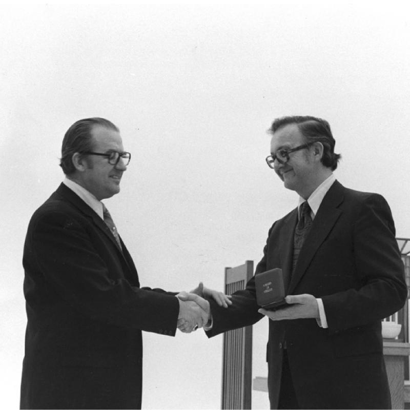 Edward Maser (right), director of the David and Alfred Smart Museum at the University of Chicago, is awarded Austria's Cross of Honor in Science and Art by Austrian Consul General Eduard Adler (left). University of Chicago Photographic Archive, [apf1-04121], Special Collections Research Center, University of Chicago Library