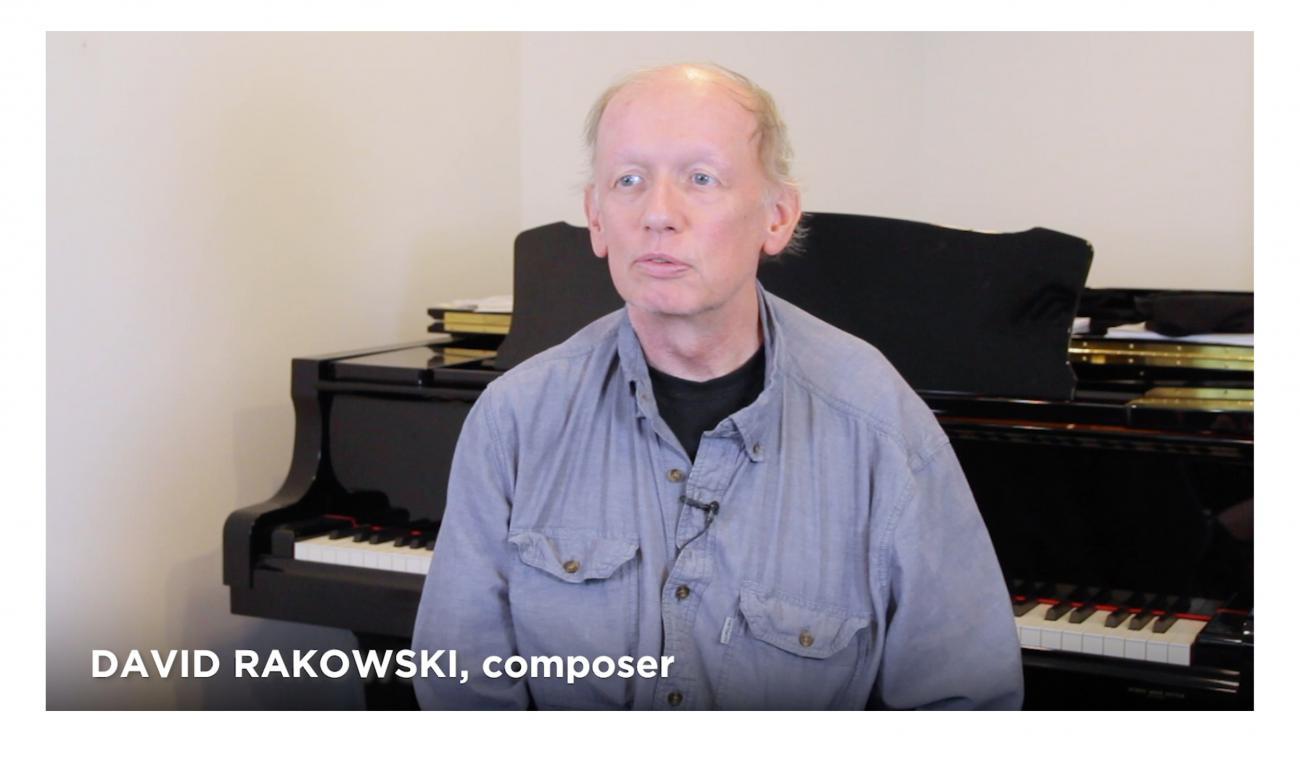 Screenshot of a video featuring composer David Raskowski