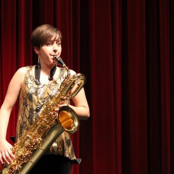 Allison Balcetis playing baritone saxophone