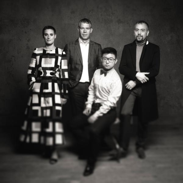Members of string quartet Quatuor Diotima posing in black and white