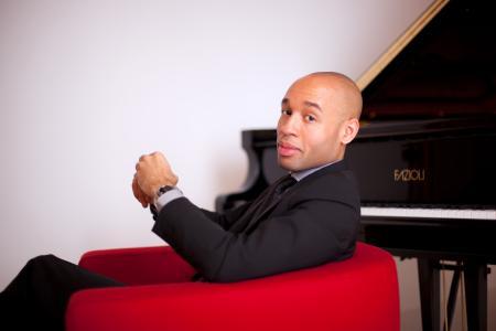 Aaron Diehl in front of a piano