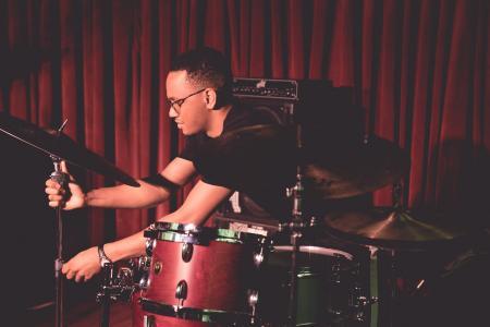 Jeremy Dutton adjusting drum kit