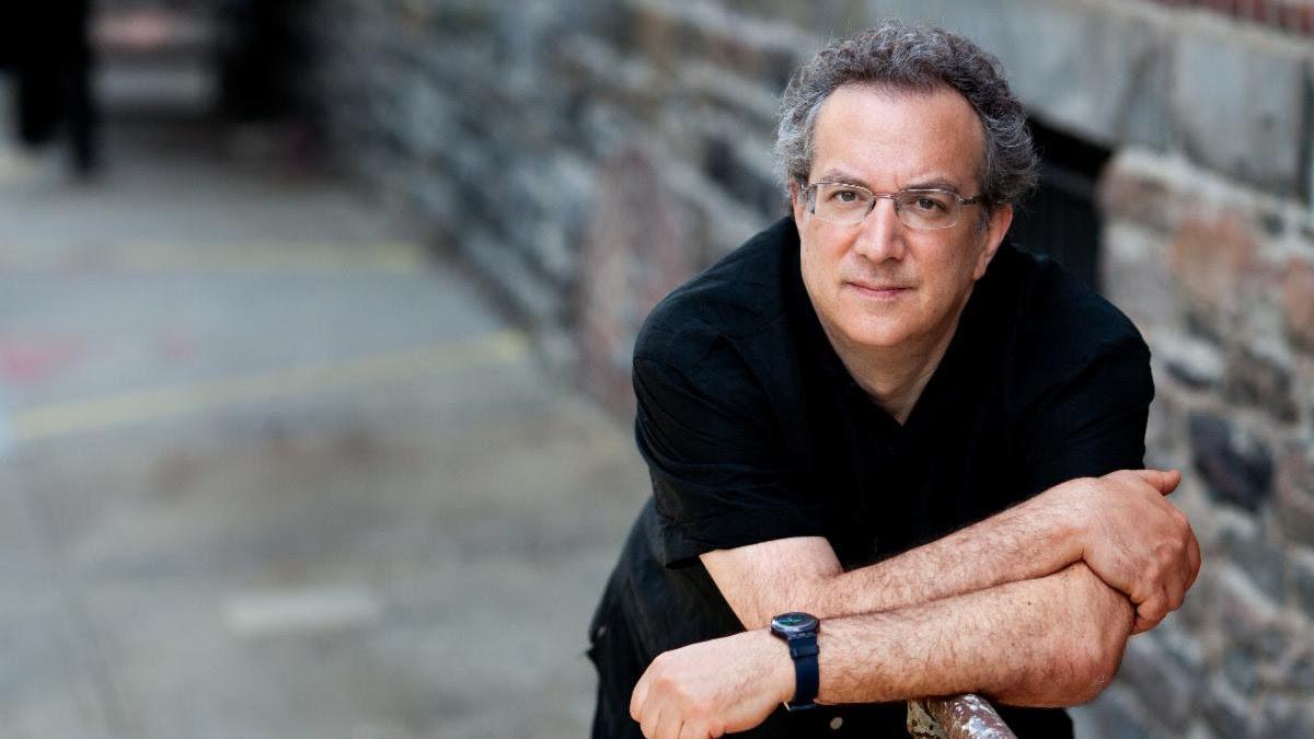 Uri Caine leaning on railing