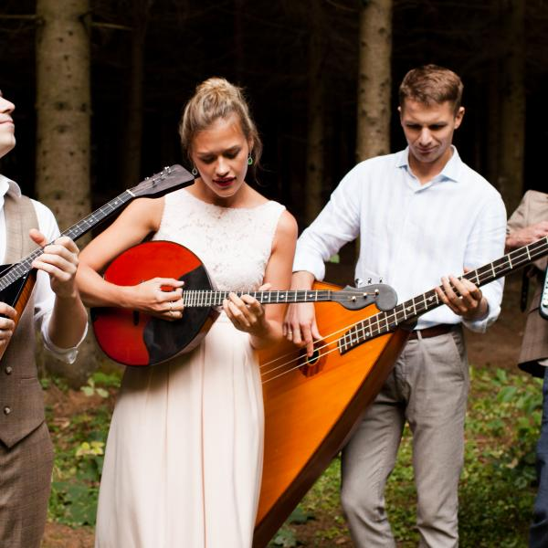 Russian Renaissance with balalaikas, domra, and button accordion in forest