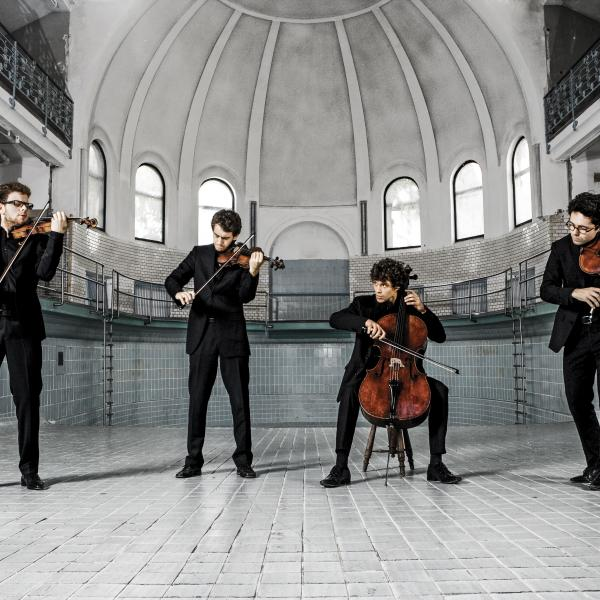 Vision String Quartet performing with instruments