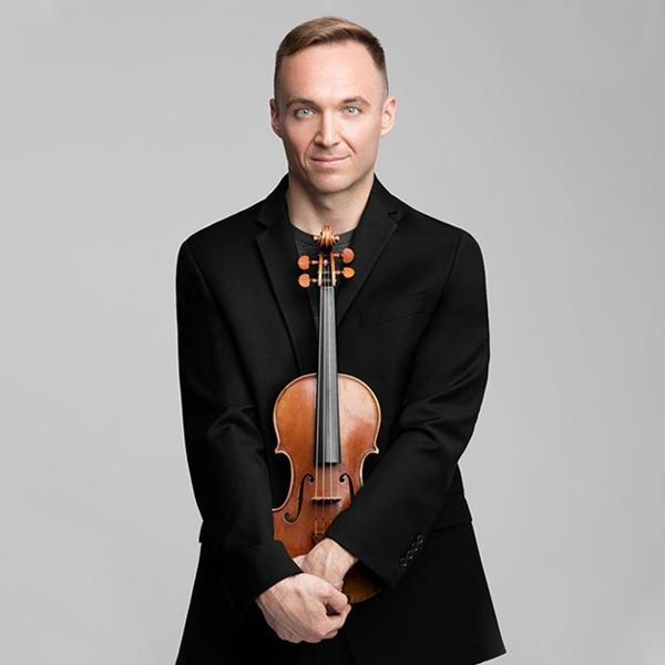 Austin Wulliman holding his violin