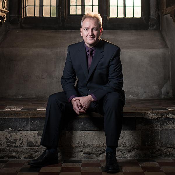 Nigel Short sitting on stone steps