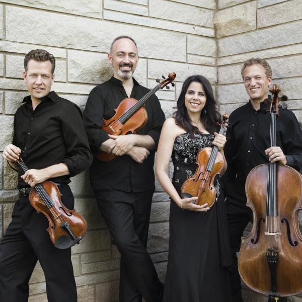 Pacifica Quartet against white stone wall