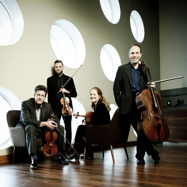 St. Lawrence String Quartet seated with instruments