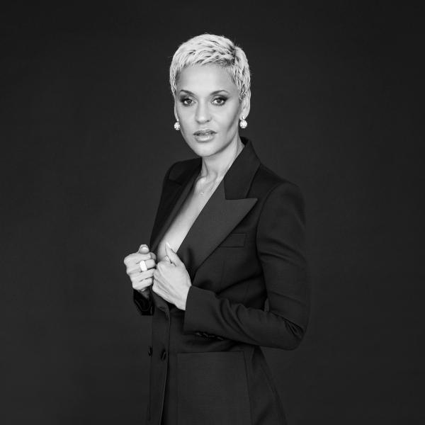 Black-and-white photo of Mariza in a black suit