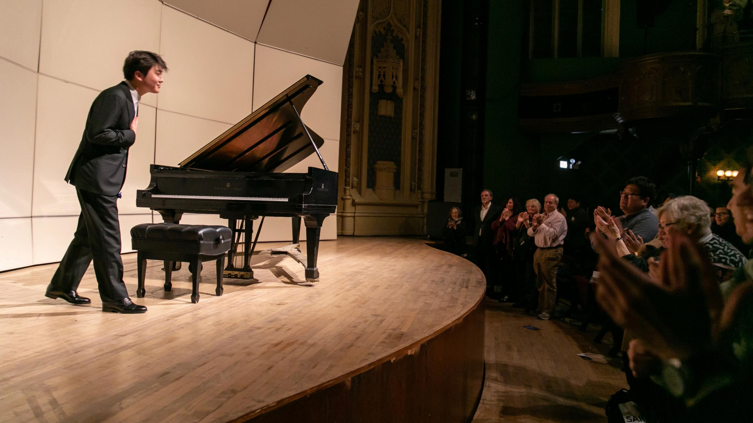 Pianist Seong-Jin Cho takes about to thank an appreciative audience