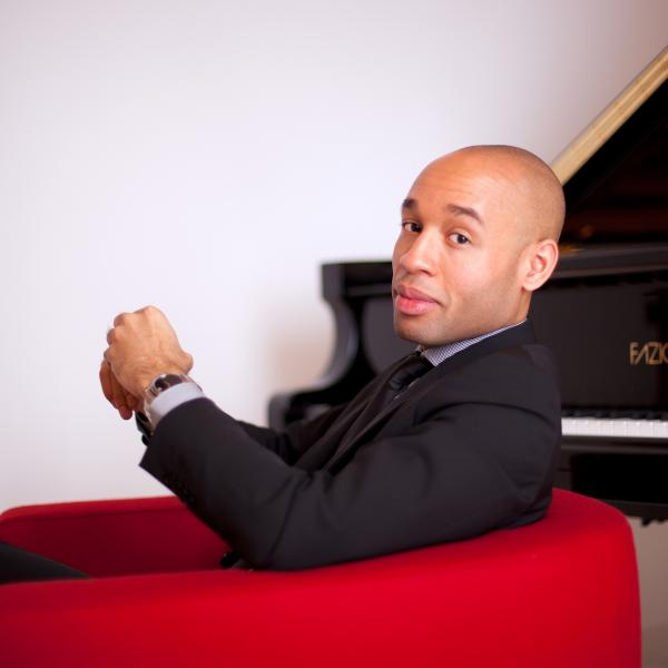 Aaron Diehl in front of a piano