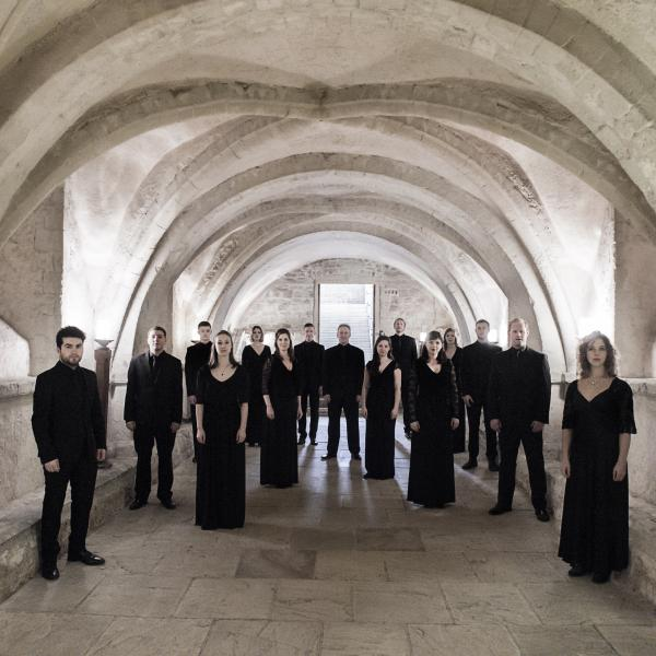 Tenebrae choir in a vaulted stone hallway