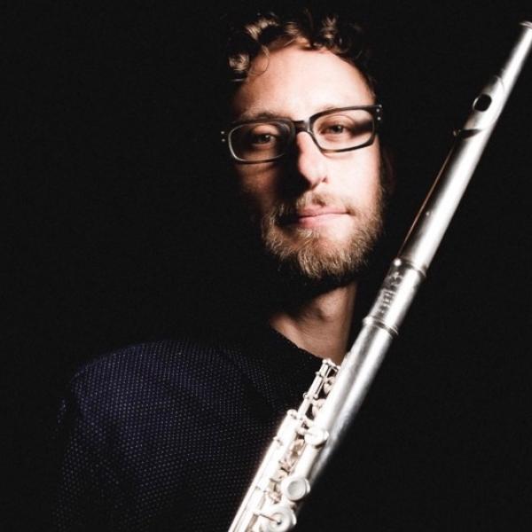 Tim Munro holding flute