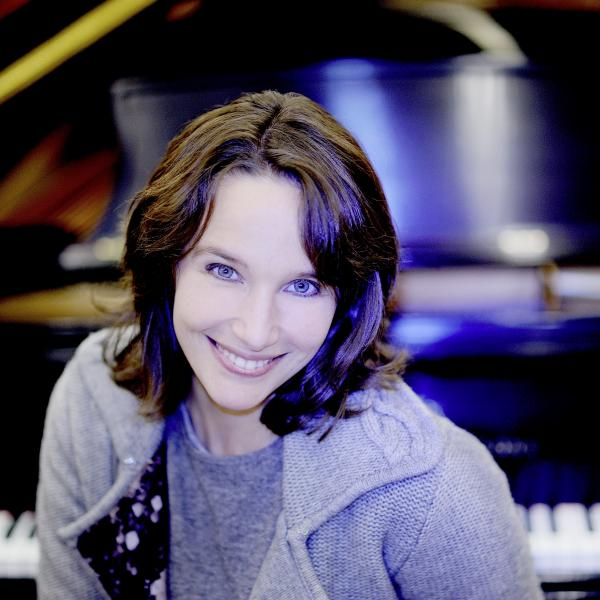 Hélène Grimaud in front of piano