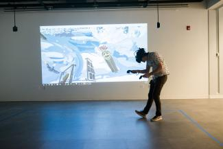 A person bending while playing a Virtual Reality game.
