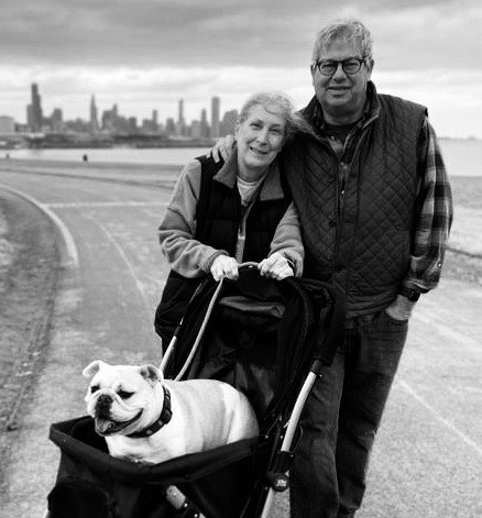 John and Monica Flynn walk their bulldog in a stroller on the lakefront path.