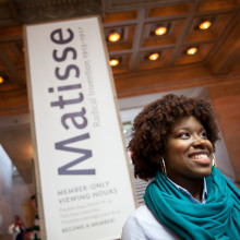 A female student stands outside a Matisse exhibit in Chicago.