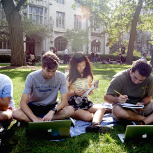 Students study on the quad in summer.
