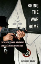 The cover of a book featuring a person aiming a modern rifle, standing in front of a member of the KKK in Klan garb.