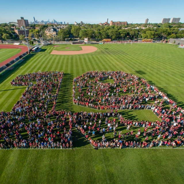 The entire UChicago class of 2019 forms the shape of the number 19 on Stagg Field