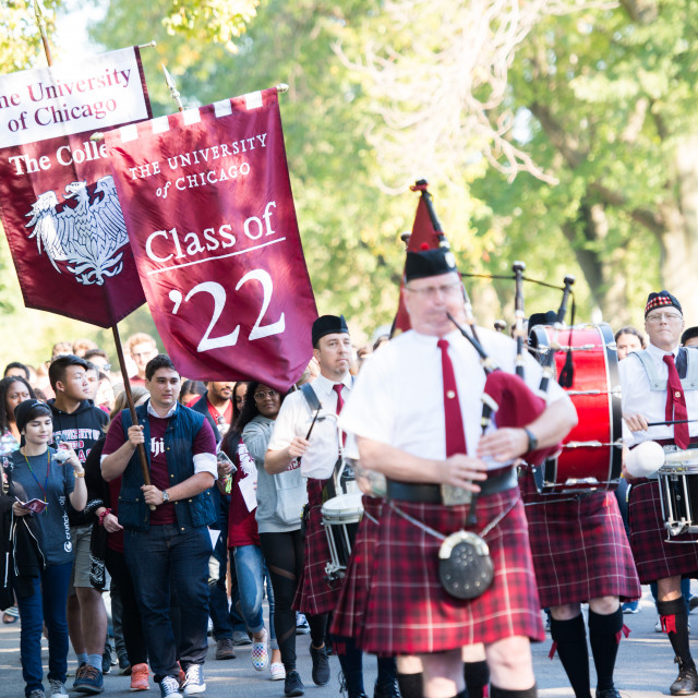 Bagpipers and drummers lead a procession for opening convocation, class of 2022.