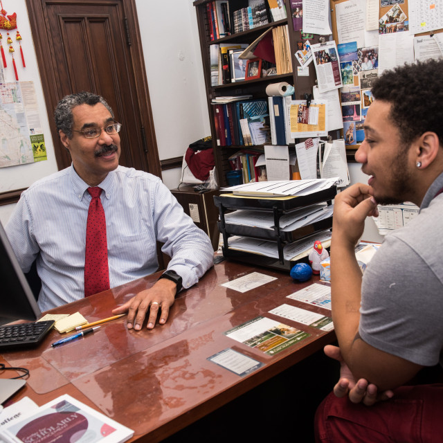 Adviser Shawn Hawk speaks with a student in his office.