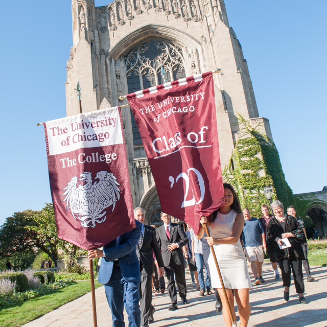 Students hold class of 2020 banners in front of Rockefeller Chapel