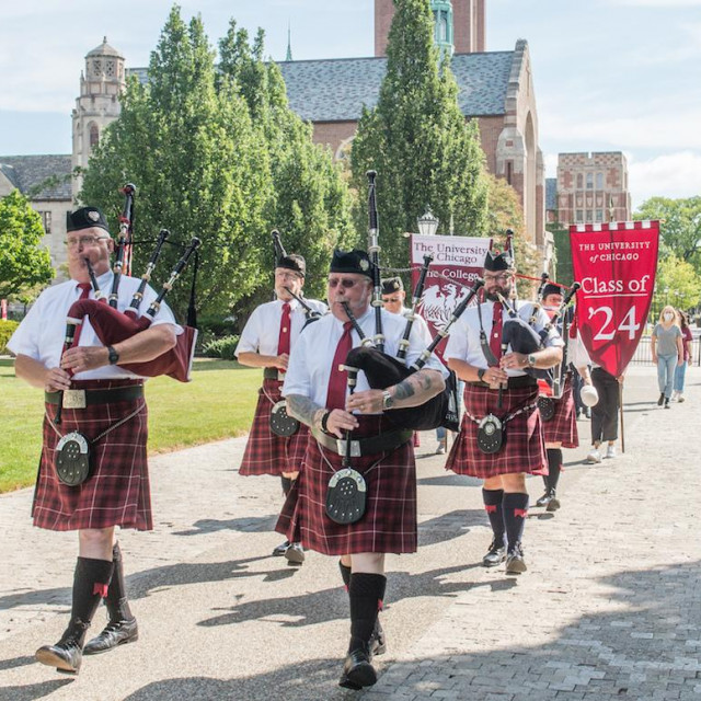 Rows of maroon-clad bagpipers process across the Quad in a socially distant ceremony.