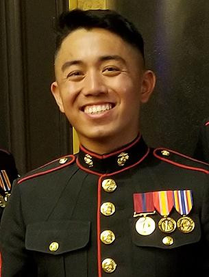A man wearing a Marine Corps uniform is pictured.