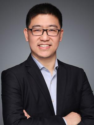 Portrait of Yucheng Peng in suit.