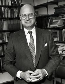 Portrait of Neil Harris in office with books in background.