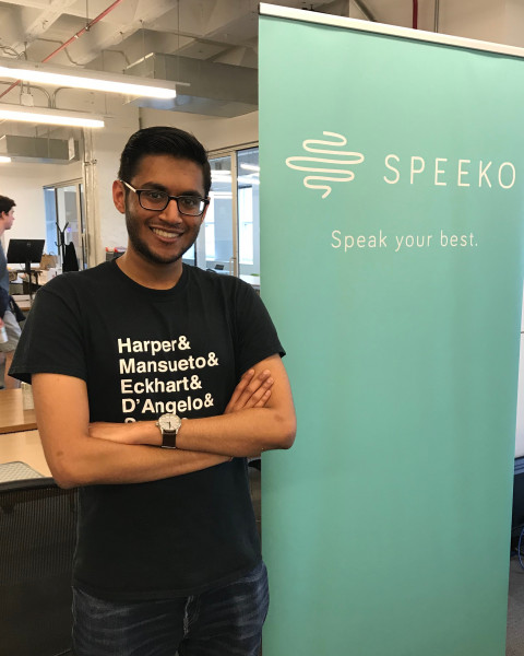 "Portrait of Arjun Patel in from a sign that reads ""Speeko. Speak your mind."""