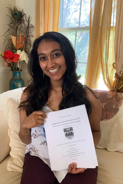 Sahana Ramani poses with her thesis