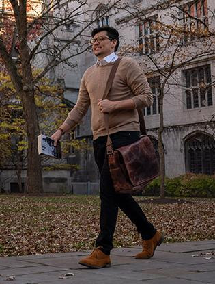 Ricky Holder walks across the autumnal Classics quad.