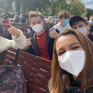 Students take a selfie on a boat on the Seine River