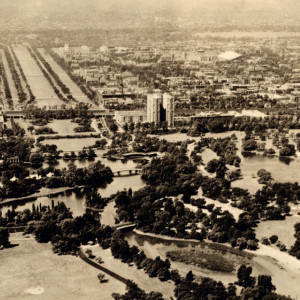 A brown and white aerial photo of water and parks surrounding the Hyde Park neighborhood.