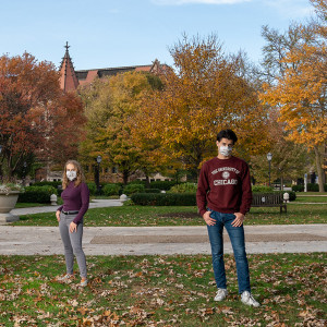 A portrait of Sheila Tume, Lauren Kingsly, Emilio Rosas Linhard and Josette Huang on a fall-colored campus quad