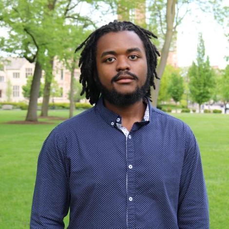 Portrait of Jay Gibbs outside.