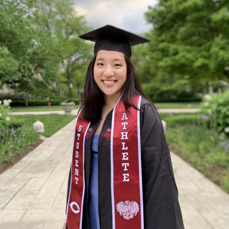 Portrait of Yifan Mao outside in cap and gown.