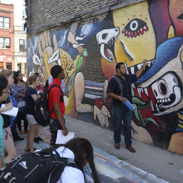 Students learn about the Mexican mural tradition in the Pilsen neighborhood.