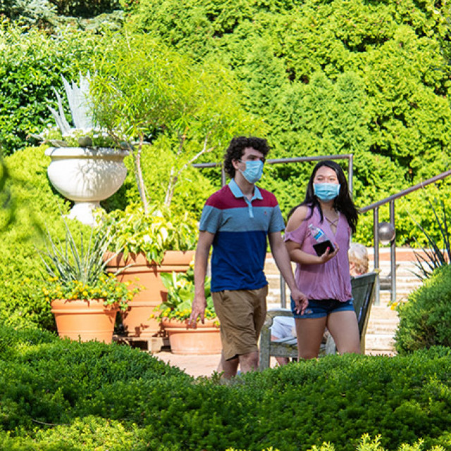 Two students explore the botanic garden in masks