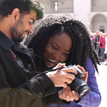 Two students review a picture on a digital camera.