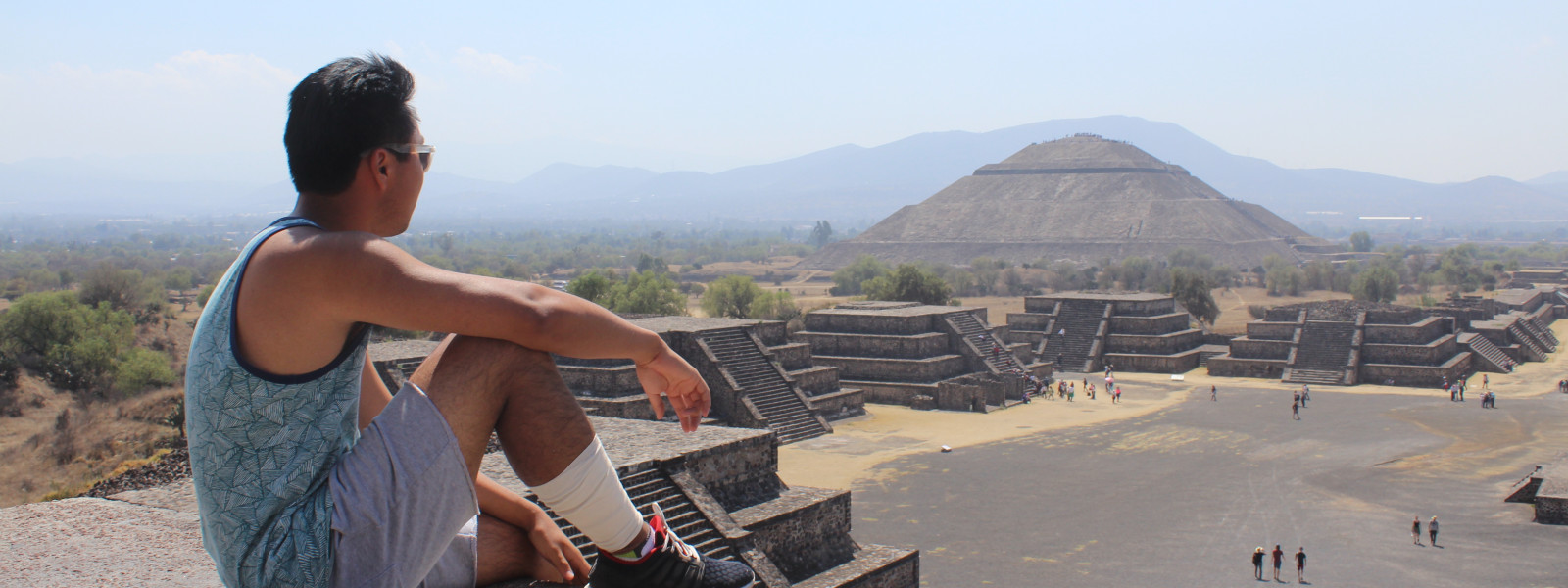 Student sitting and enjoying view of the Pyramid of the Moon