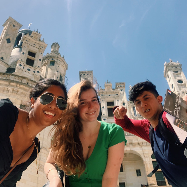 Three students strike a pose at the Château de Chambord.