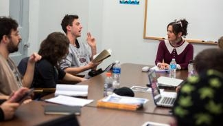 Lect. Rachel DeWoskin (right) leads students in a fiction writing course at Taft House.